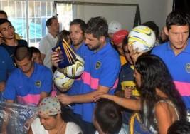 Jugadores de Boca visitaron un taller de chicos con Síndrome de Down